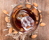 Glass with Amaretto and Ice — Stock Photo
