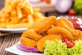 Some fresh made Chicken Nuggets (with chips) — Stock Photo