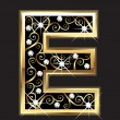 Royalty-Free Stock Векторное изображение: E gold letter with swirly ornaments