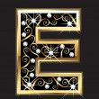 E gold letter with swirly ornaments — Stock vektor