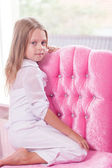 Little girl sitting on the chair — Stock Photo