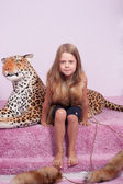Little girl and toy leopard — Stock Photo