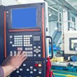 Workers in the operation of CNC machine tools — Stock Photo #12450385