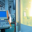 Workers in the operation of CNC machine tools — Stock Photo #12450391