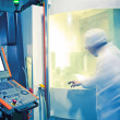 Workers in the operation of CNC machine tools — Stock Photo #12450392