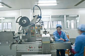 Technicians working in the pharmaceutical production line — Stock Photo