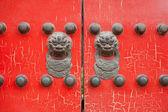 Red wooden door on the animal — Stock Photo