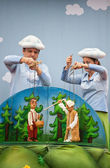 Human sculptures in the puppet theater, Made in China — Stock Photo
