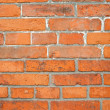 Red brick building wall - Stock Photo