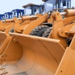 Foto Stock: Row of Excavators