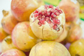 Poke pomegranate — Stock Photo