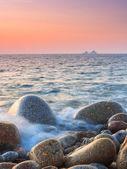 Sunset on a boulder beach — Stock Photo