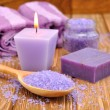 Stock Photo: Purple sesalt and burning candle
