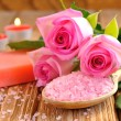 Sea salt, rose, soap and a burning candle — Stock Photo