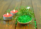 Sea salt, rosemary and a burning candle — Stock Photo