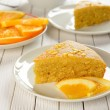 Stock Photo: Orange cake on white table