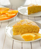 Orange cake on a white table — Stock Photo