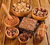 Chocolate, nuts and spices — Stock Photo