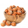 Постер, плакат: Hazelnuts in a wooden bowl