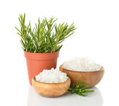 Salt in a wooden bowl and rosemary — Stock Photo