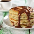 Stock Photo: Pancakes with poppy and chocolate sauce