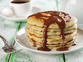 Pancakes with poppy and chocolate sauce — Stock Photo