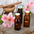 Stock Photo: Essential oil and flowers