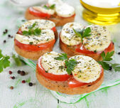 Bruschetta with tomatoes and mozzarella — Stock Photo