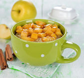 Oatmeal with apple — Stock Photo