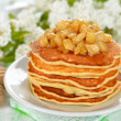 Stock Photo: Pancakes with caramelized apples