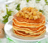 Pancakes with caramelized apples — Stock Photo