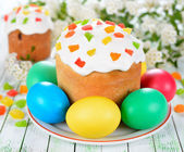 Easter cake and eggs on a white table — Stock Photo