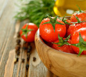 Tomatoes in a bowl — Stock Photo