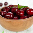 Stock Photo: Fresh cherries in a wooden bowl