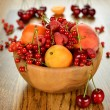 Fruit in wooden bowl — Stock Photo