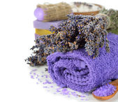 Towel and a bunch of lavender — Stock Photo