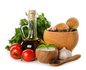 Mortar with spices, olive oil and fresh vegetables — Stock Photo