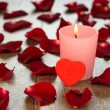 Rose petals and candle — Stock Photo