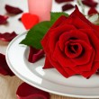 Rose on a white plate — Stock Photo