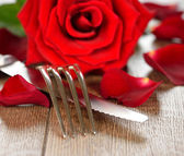 Cutlery and rose — Stock Photo