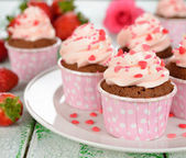 Chocolate cupcakes with pink cream — Stock Photo