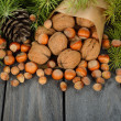 Nuts and green twigs — Stock Photo #33469725