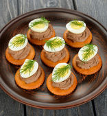 Canape with pate and egg — Stock Photo