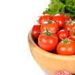 Foto Stock: Tomatoes in wooden bowl