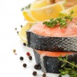 Raw salmon with herbs and spices — Stock Photo