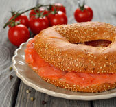 Bagel with salmon — Stock Photo