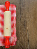Rolling pin and red napkin — Stock Photo