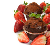 Chocolate cupcakes with strawberries — Stock Photo