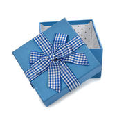 Blue box decorated with ribbon — Stock Photo