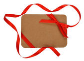 Cardboard card decorated with red ribbon — Foto de Stock